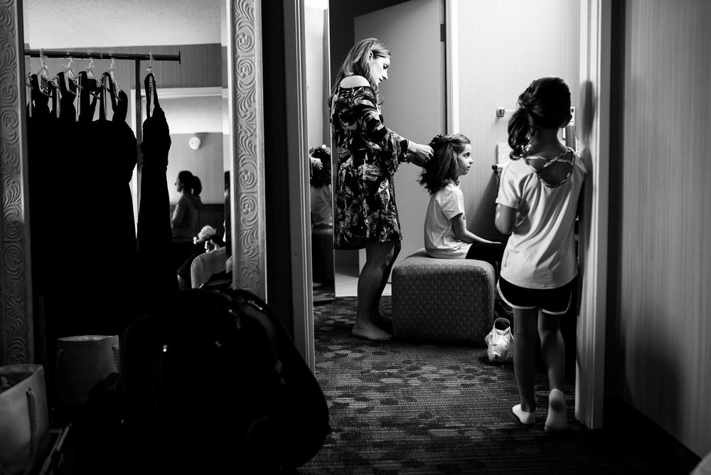 Flower girls getting ready before a St. Charles Country Club wedding.
