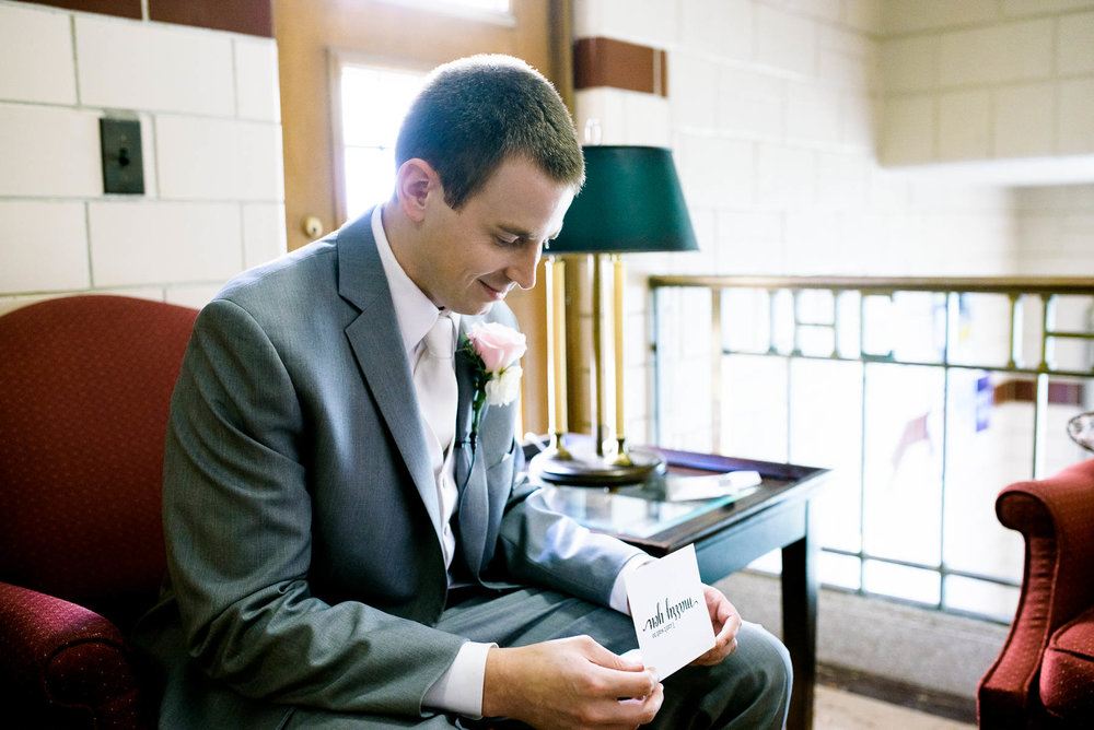 Groom reads a note from the bride before the ceremony at Baker Memorial United Methodist Church in St. Charles.