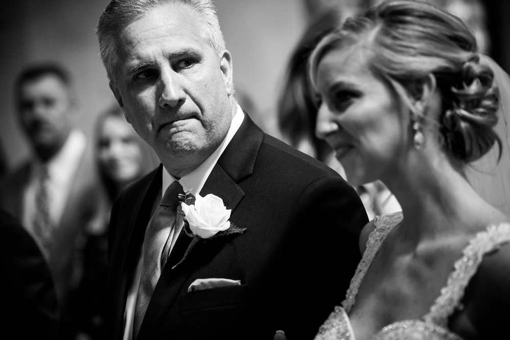 Father gets emotional during his daughter's wedding ceremony at Baker Memorial United Methodist Church in St. Charles