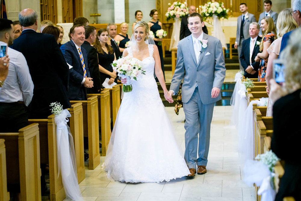 Bride and groom walk down the aisle at Baker Memorial United Methodist Church in St. Charles