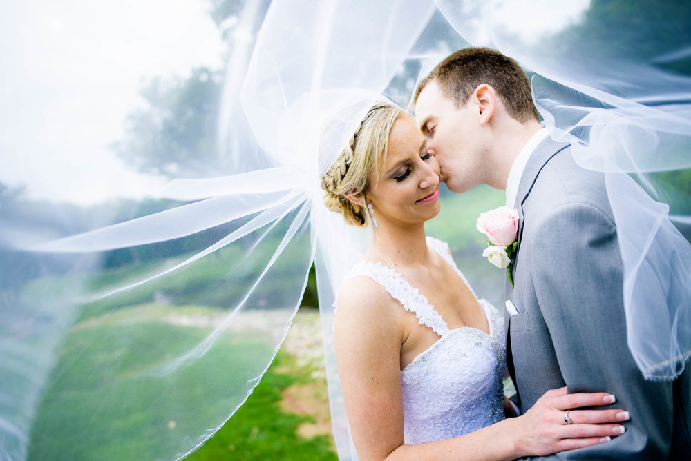 Creative portrait of bride and groom during their wedding at the St. Charles Country Club.
