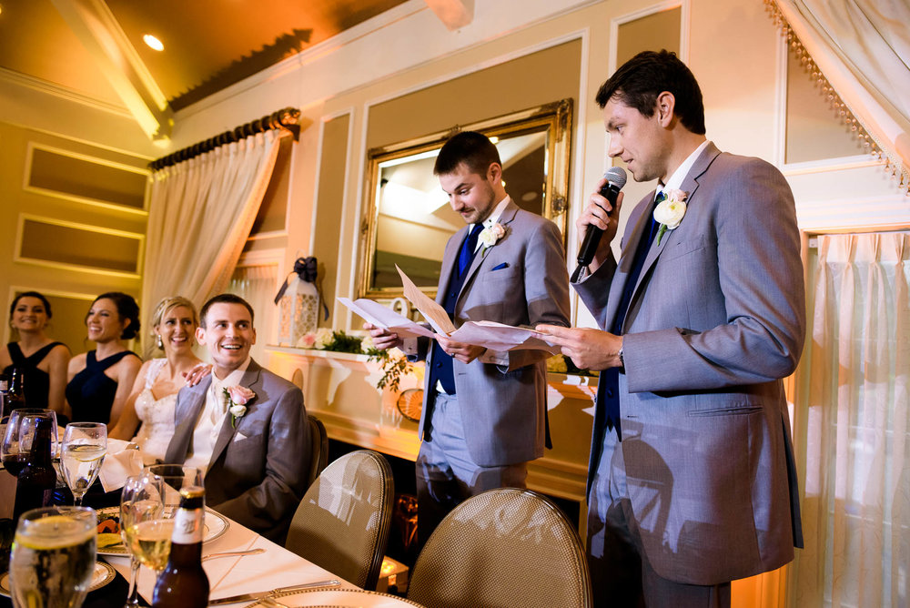 Best men toast during a St. Charles Country Club wedding.