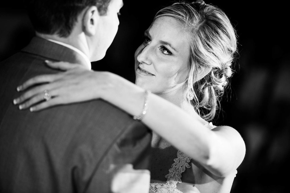 Bride and groom first dance during their St. Charles Country Club wedding.