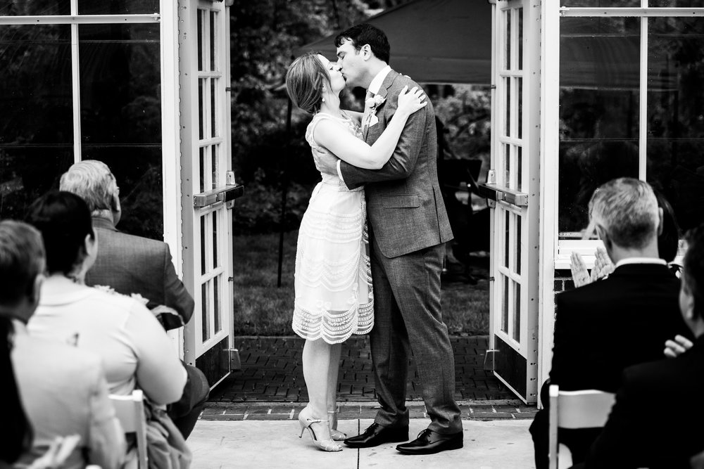 First kiss during a Cheney Mansion wedding in Oak Park.