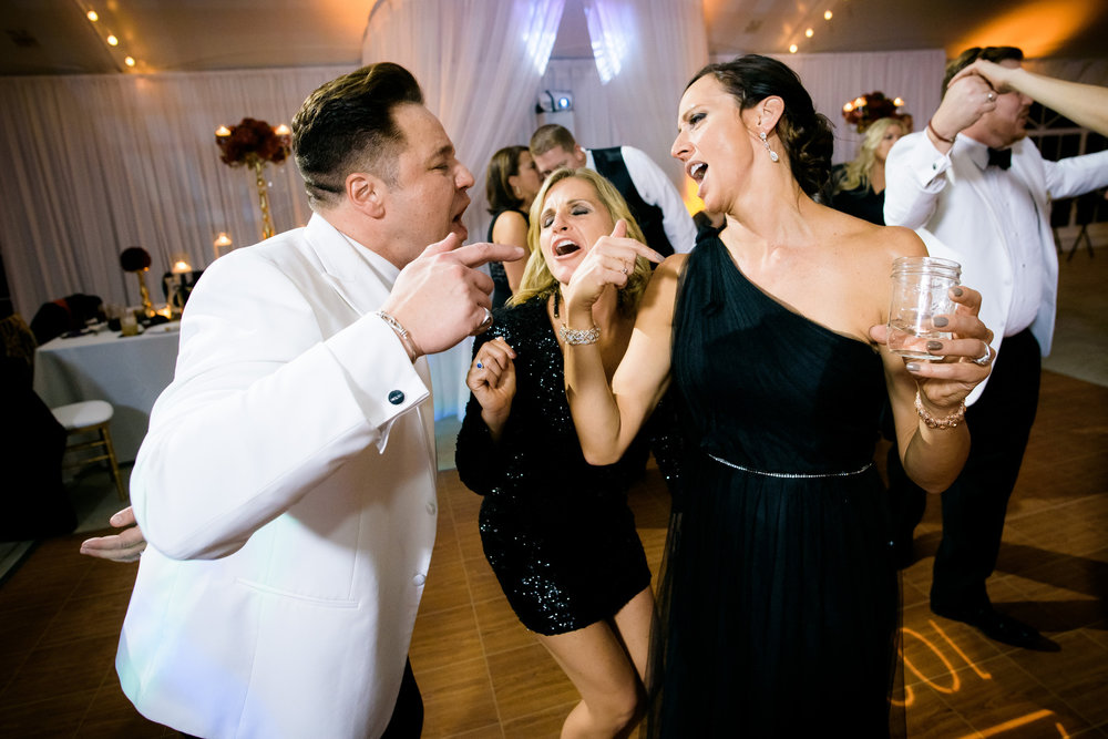 Funny dance floor moment during a wedding at at Heritage Prairie Farm.