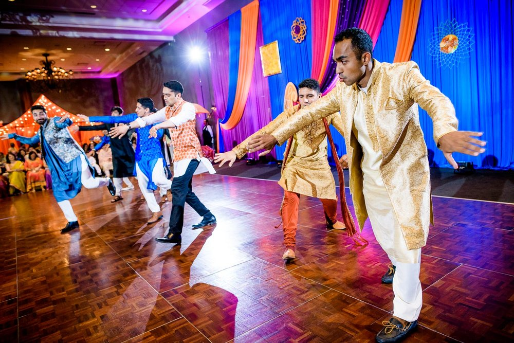 Groomsmen dance during an Indian wedding sangeet at Stonegate Banquets in Hoffman Estates.