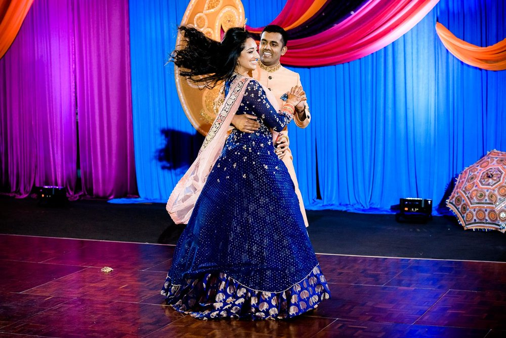 Bride and groom dance during an Indian wedding sangeet at Stonegate Banquets in Hoffman Estates.
