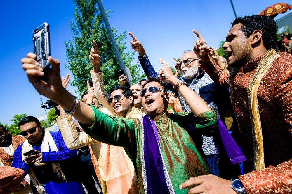 Fun baraat dancing photo during a Renaissance Schaumburg Convention Center Indian wedding.