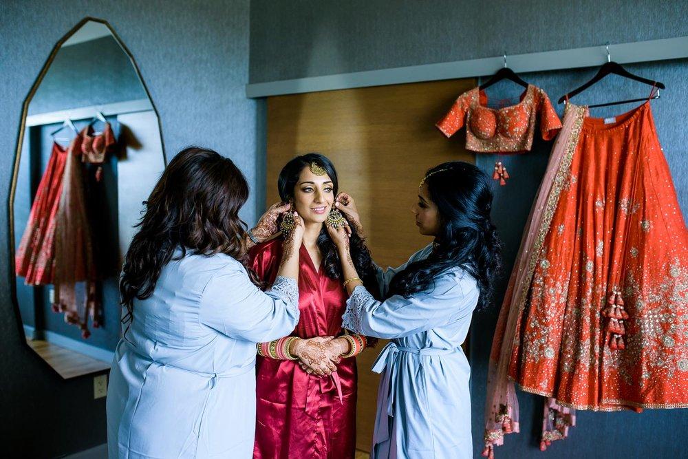Bride getting ready during her Renaissance Schaumburg Convention Center Indian wedding.