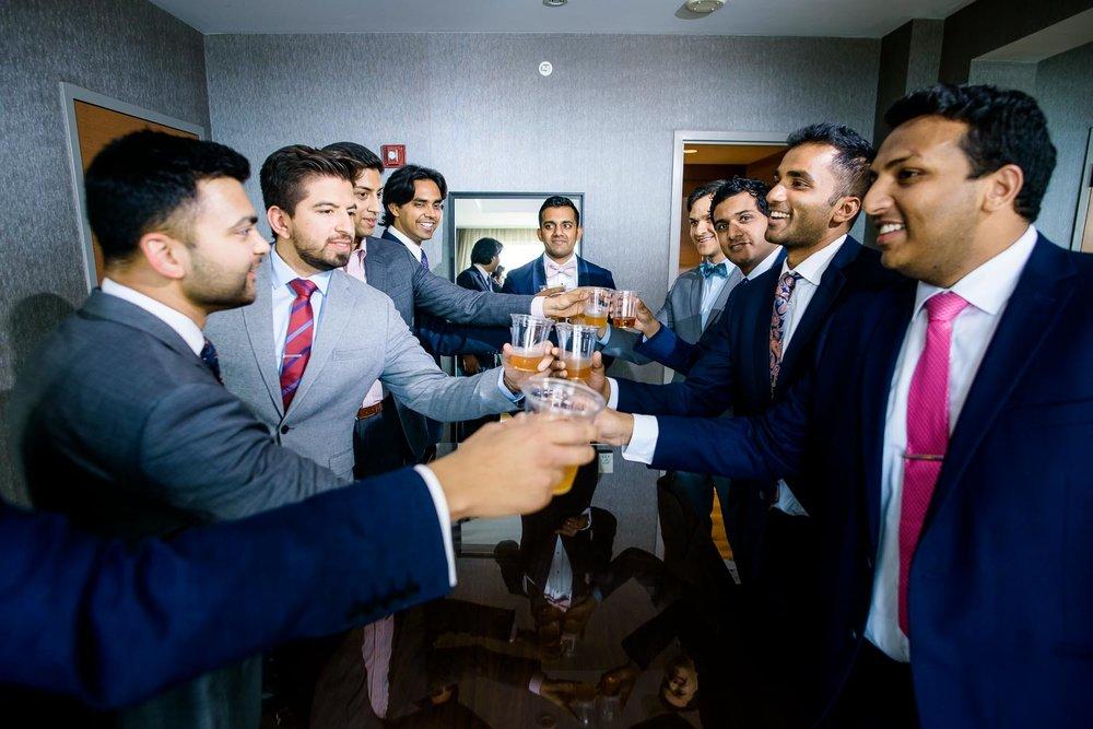 Groomsmen toast during a Renaissance Schaumburg Convention Center Indian wedding.