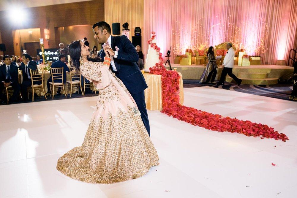 First dance during a Renaissance Schaumburg Convention Center Indian wedding reception.