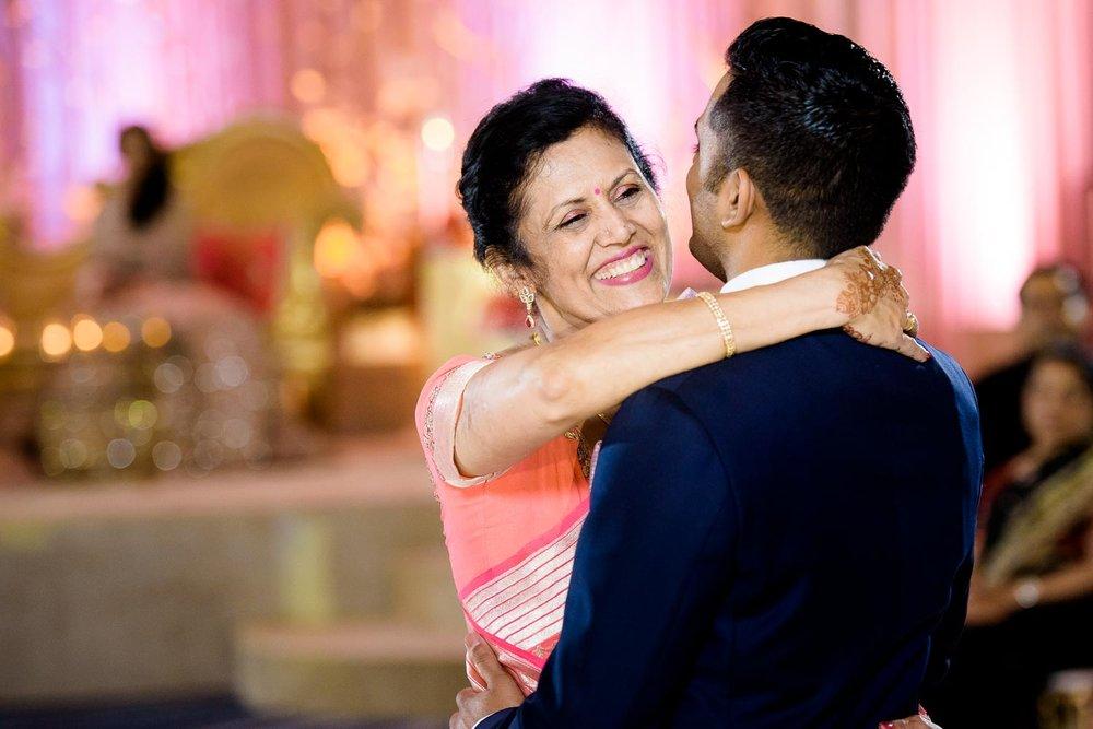 Mother son dance during a Renaissance Schaumburg Convention Center Indian wedding reception.