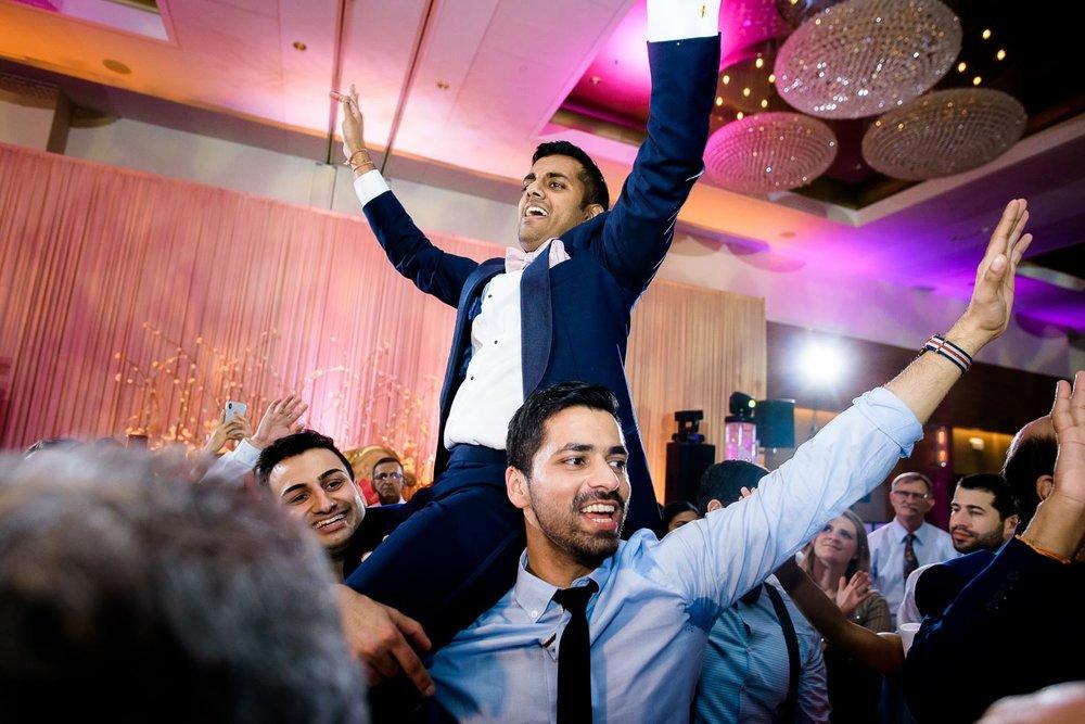 Groom during a Renaissance Schaumburg Convention Center Indian wedding reception.