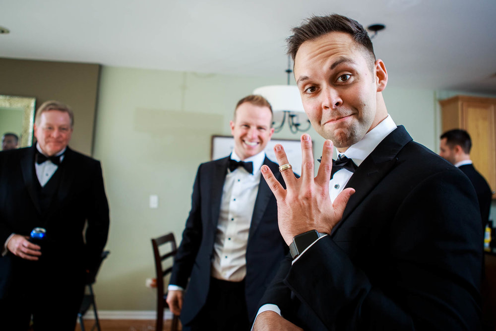 Best man holds the rings during a Mid America Club wedding Chicago.