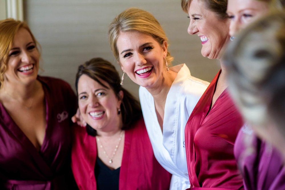 Bride and bridesmaids share a laugh before a Mid America Club wedding Chicago.