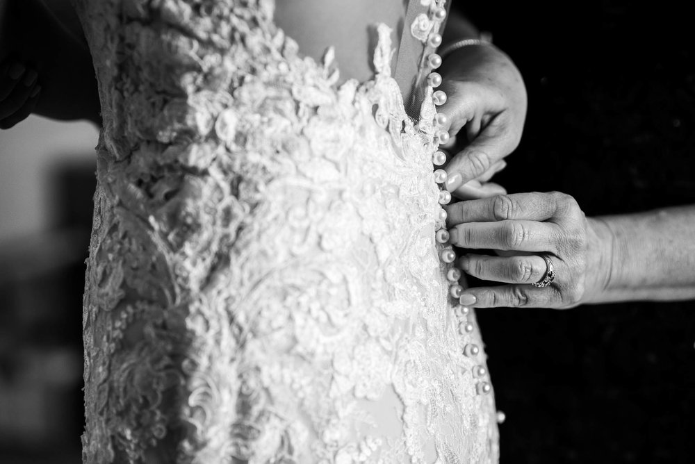 Bride getting her dress on before a Mid America Club wedding Chicago.