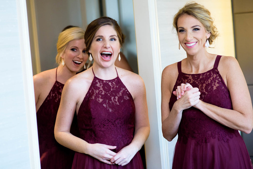 Bridesmaids react to seeing the bride during a Mid America Club wedding Chicago.
