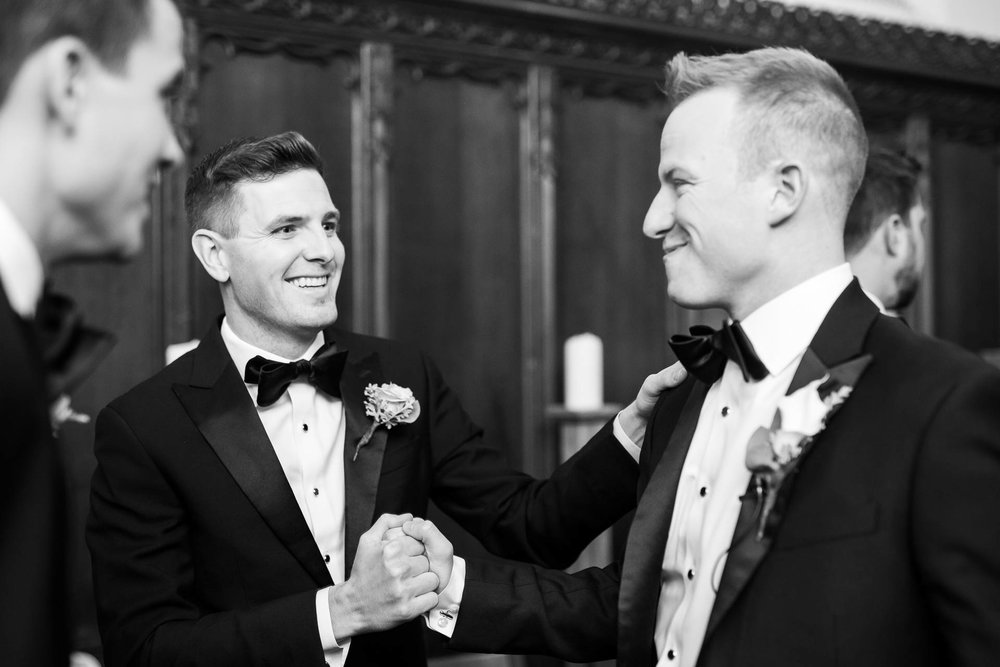 Groom shares a moment with the best man before the wedding ceremony at Fourth Presbyterian Church in Chicago.