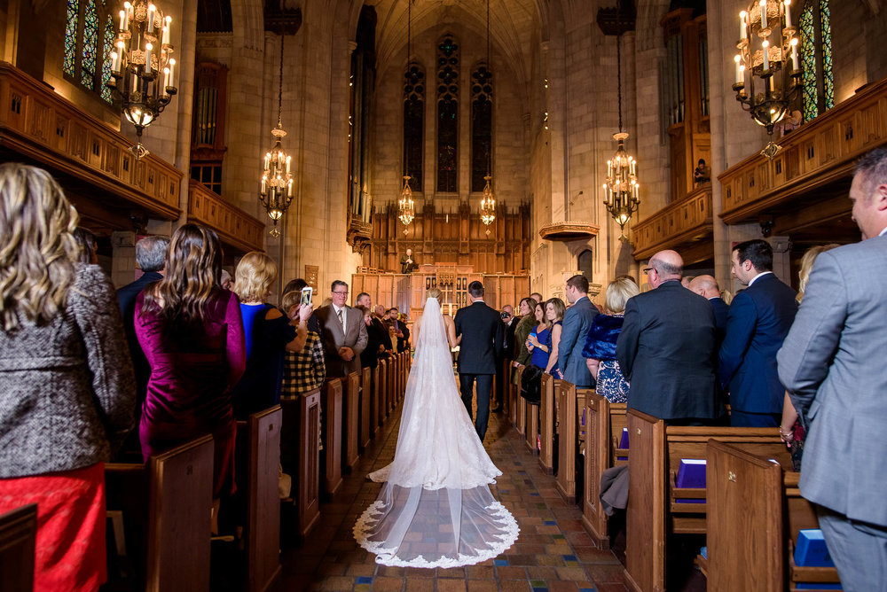 Bride walking down the aisle during a wedding ceremony at Fourth Presbyterian Church in Chicago.