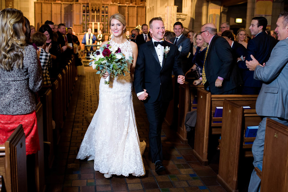 Bride and groom walk down the aisle during their wedding ceremony at Fourth Presbyterian Church in Chicago.