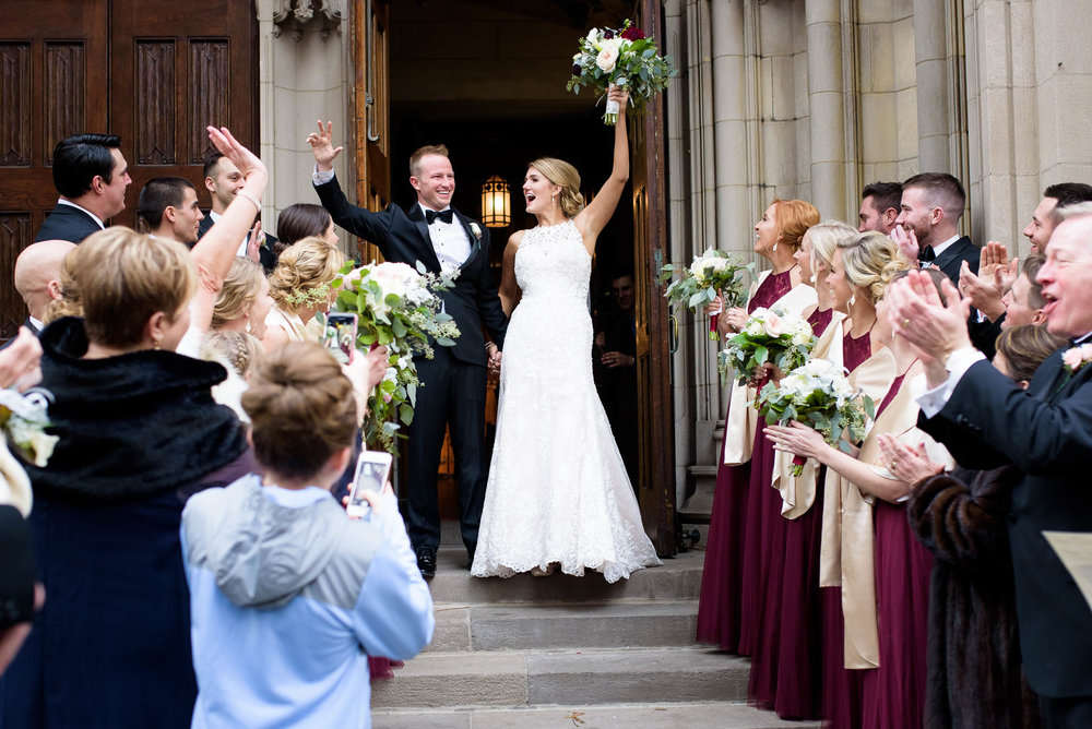 Bride and groom wedding ceremony exit at Fourth Presbyterian Church in Chicago.