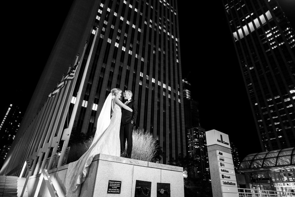 Night portrait of bride and groom outside the Mid America Club in Chicago.