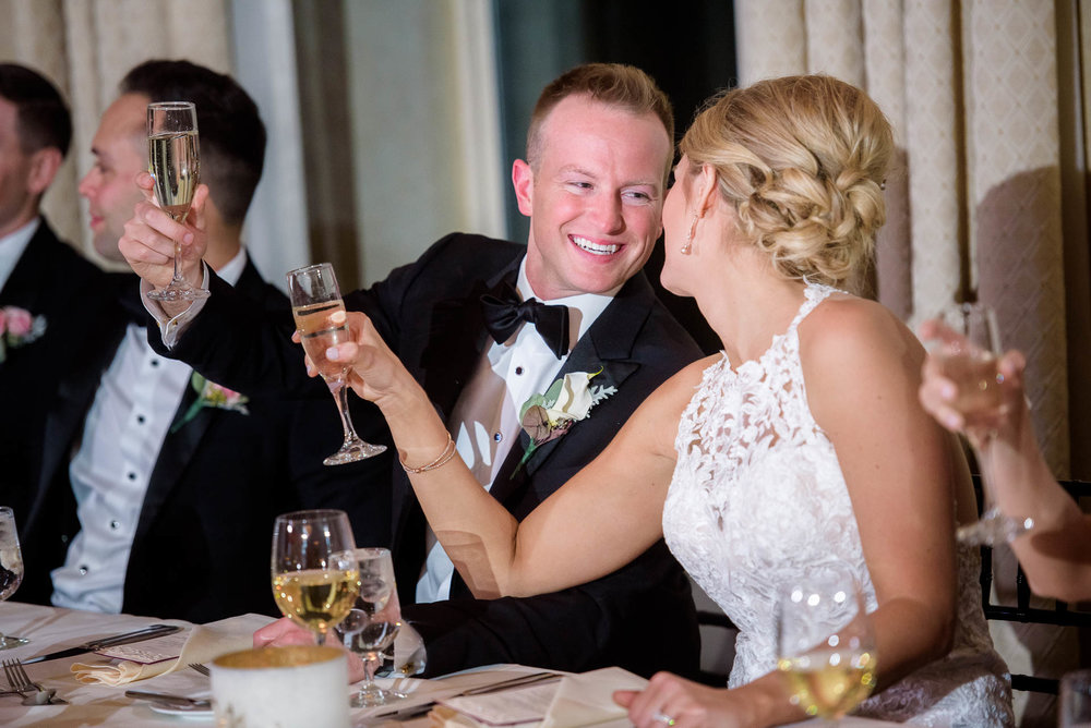 Couple toast during their wedding reception at the Mid America Club in Chicago.