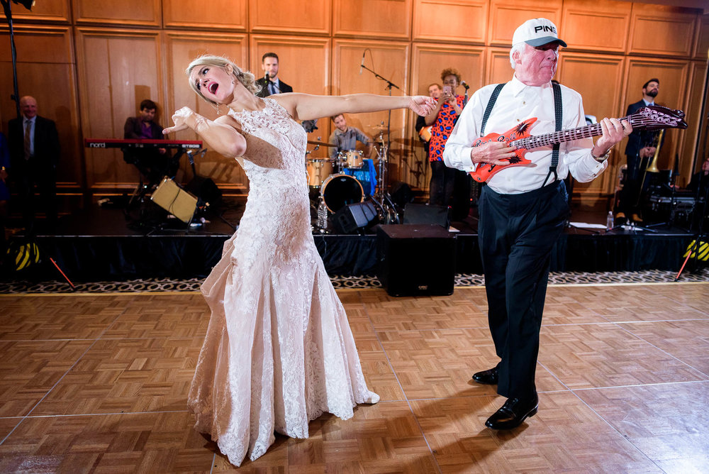 Bride and uncle dance during a wedding reception at the Mid America Club in Chicago.