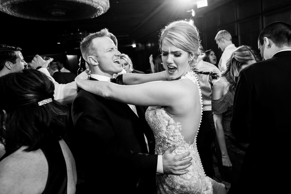 Bride and groom on the dance floor during a wedding reception at the Mid America Club in Chicago.