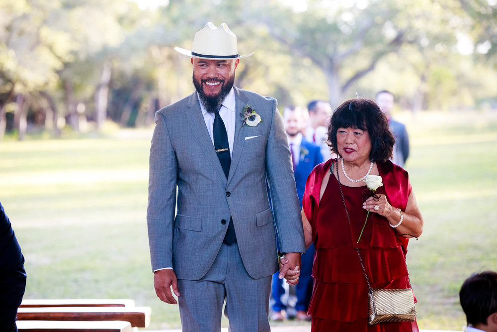 Groom walks his mom down the aisle during a Montesino Ranch wedding Austin, Texas.