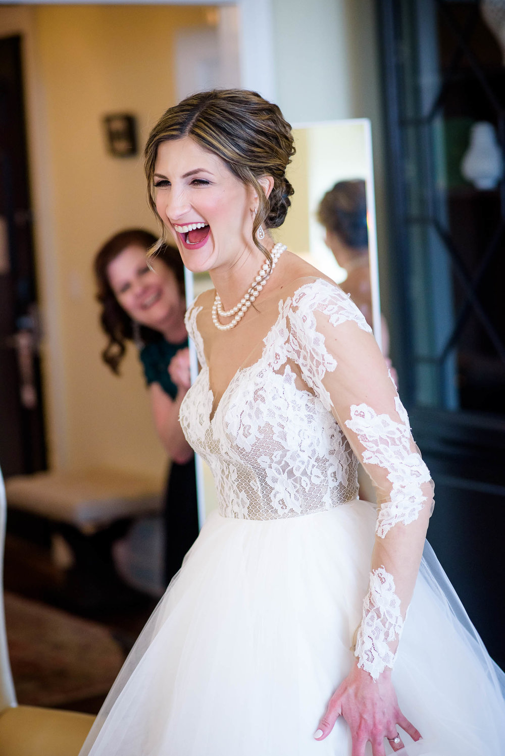 Bride laughs while getting ready during a Blackstone Chicago wedding.