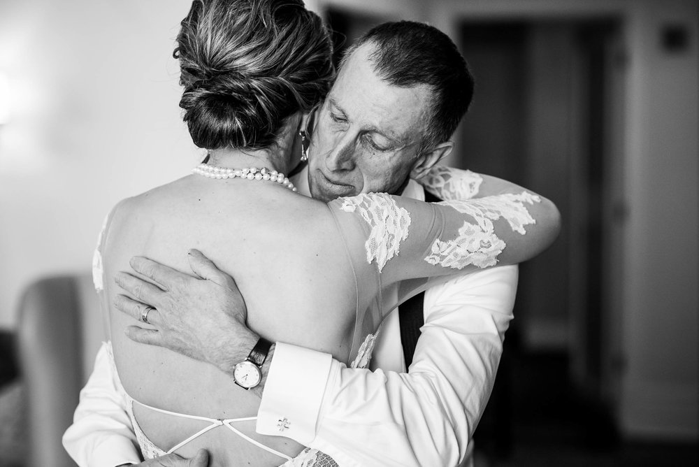 Father of the bride hugs his daughter during a Blackstone Chicago wedding.