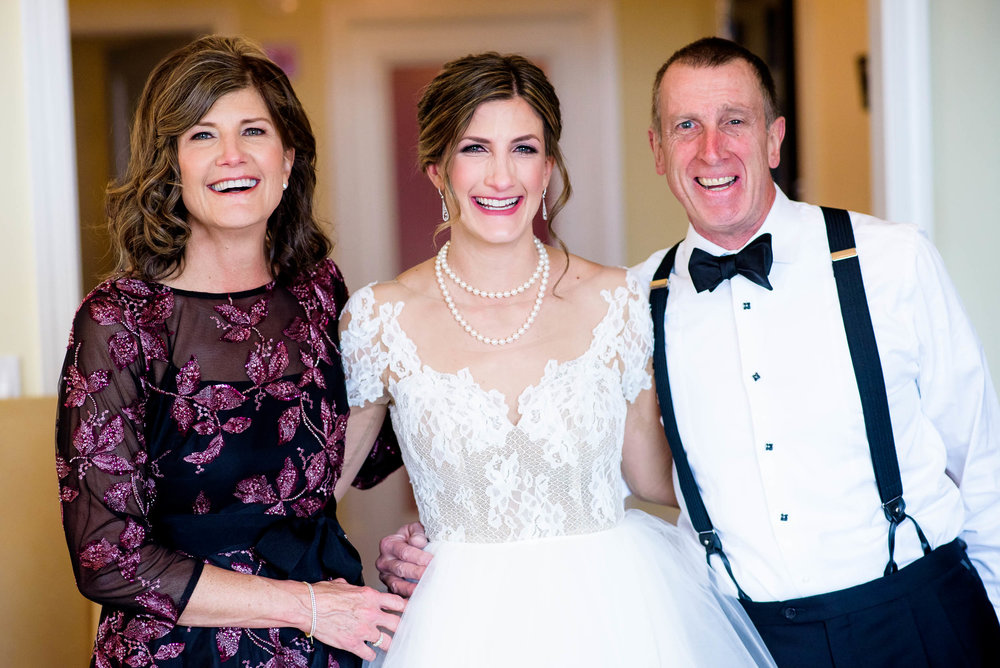 Bride with her parents during a Blackstone Chicago wedding.