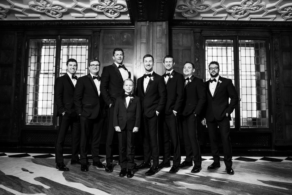 Groom with the groomsmen during a Blackstone Chicago wedding.