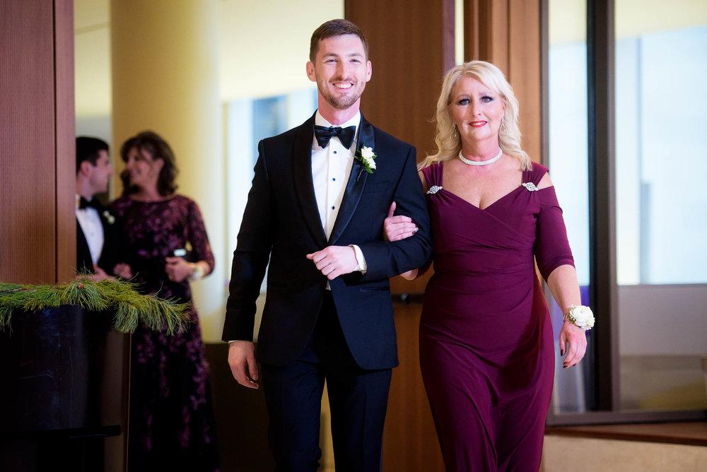 Groom walks down the aisle during a Fourth Presbyterian Church wedding.