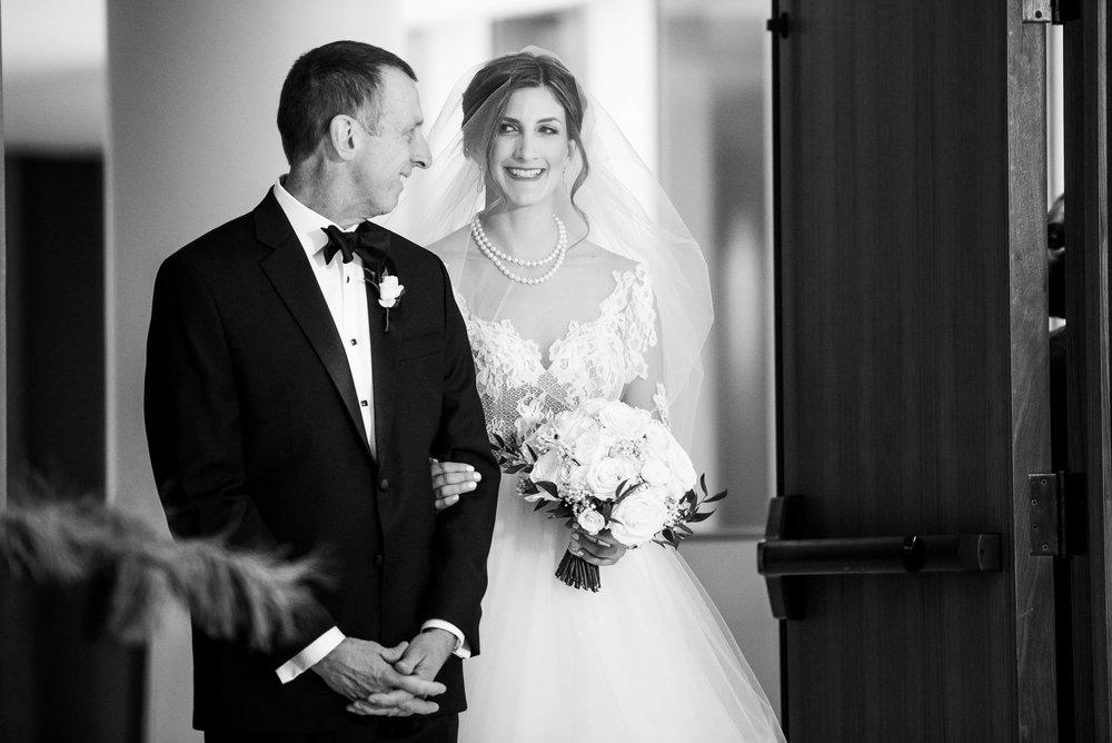 Father and bride walk down the aisle during a Fourth Presbyterian Church wedding.