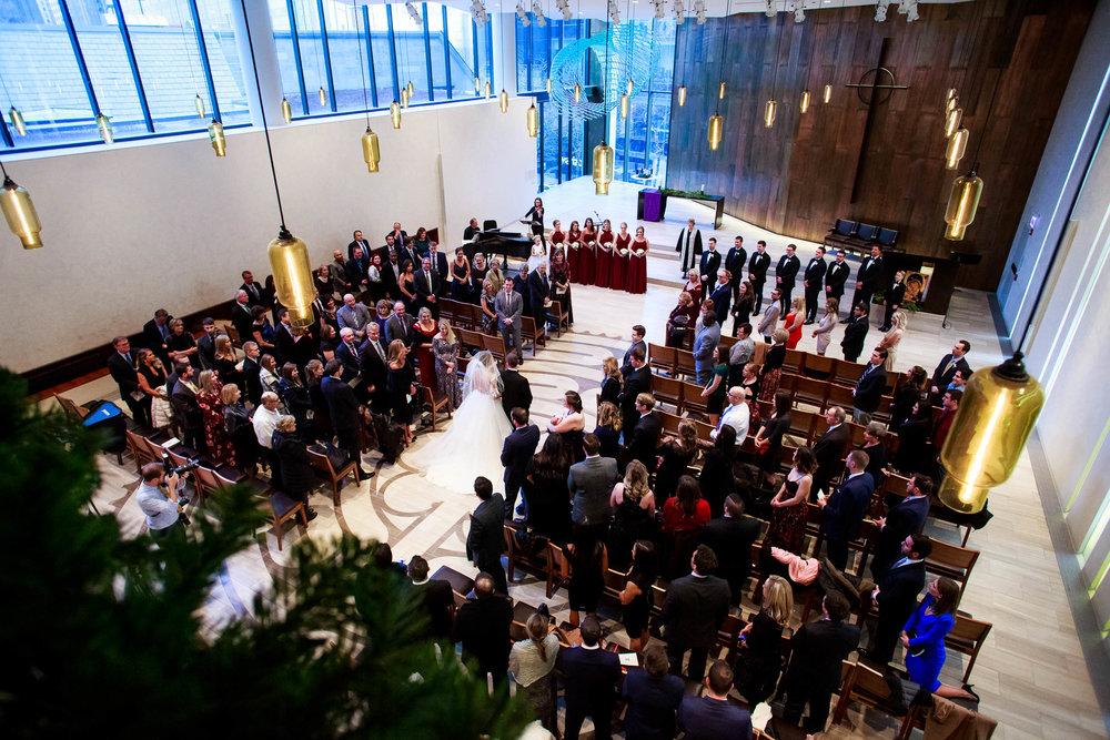 Bride walks down the aisle during a Fourth Presbyterian Church wedding.