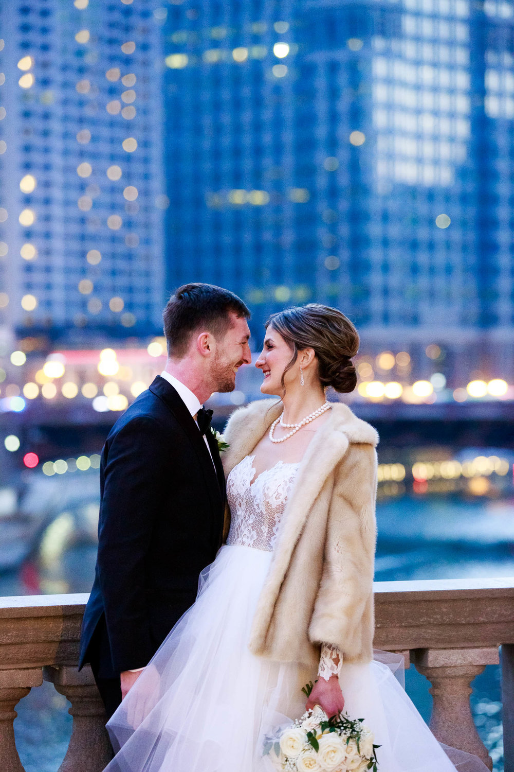 Portrait of bride and groom overlooking the Chicago River near the Wrigley Building during a Blackstone Chicago wedding.