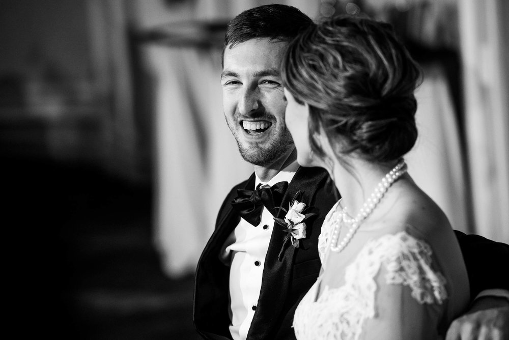 Groom reacts to the father of the bride during a Blackstone Chicago wedding.