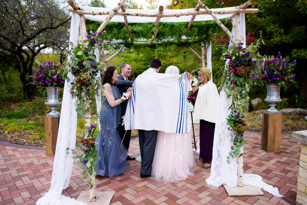 Jewish ceremony under the chuppah during an Independence Grove Chicago wedding.
