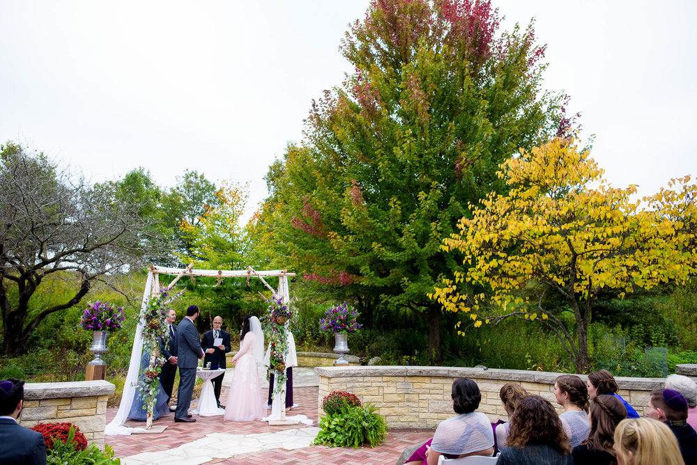 Fall colors outdoor Jewish ceremony during an Independence Grove Chicago wedding.