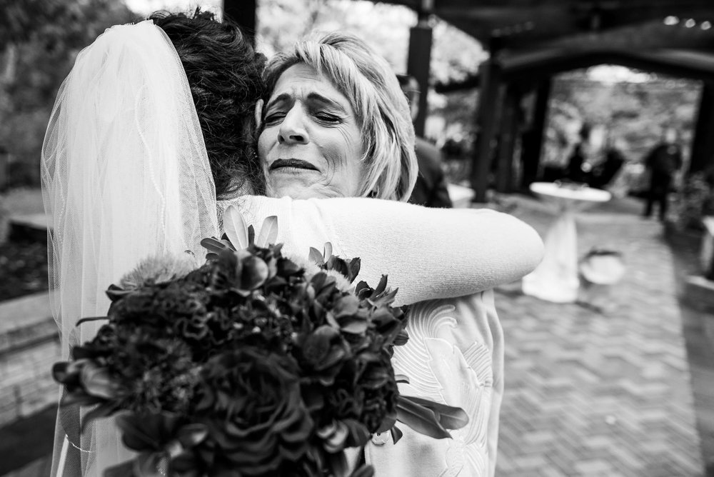 Mother and bride hug during an Independence Grove Chicago wedding.