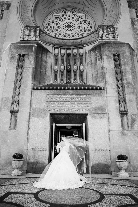 Father and bride enter Madonna Della Strada for her wedding ceremony in Chicago.
