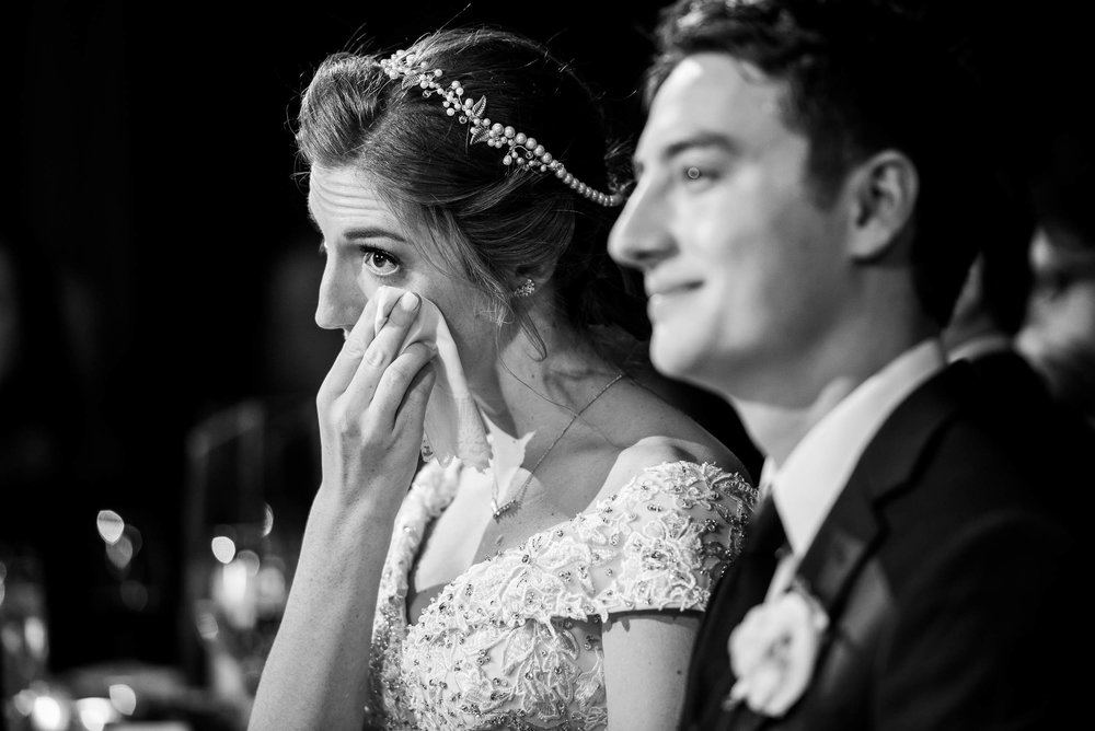 Emotional photo of the bride and groom during a Newberry Library Chicago wedding.