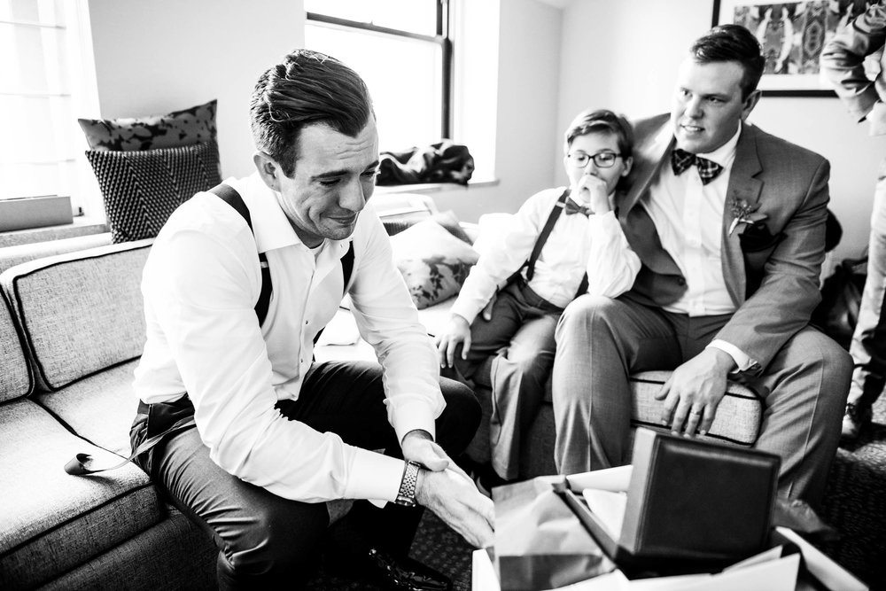 Groom cries when opening his gift from the bride during a Glessner House Chicago wedding.