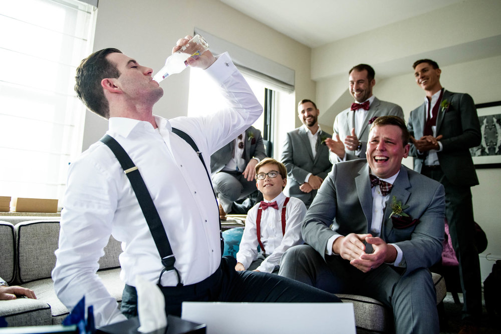 """Groom getting """"iced"""" during a Glessner House Chicago wedding."""