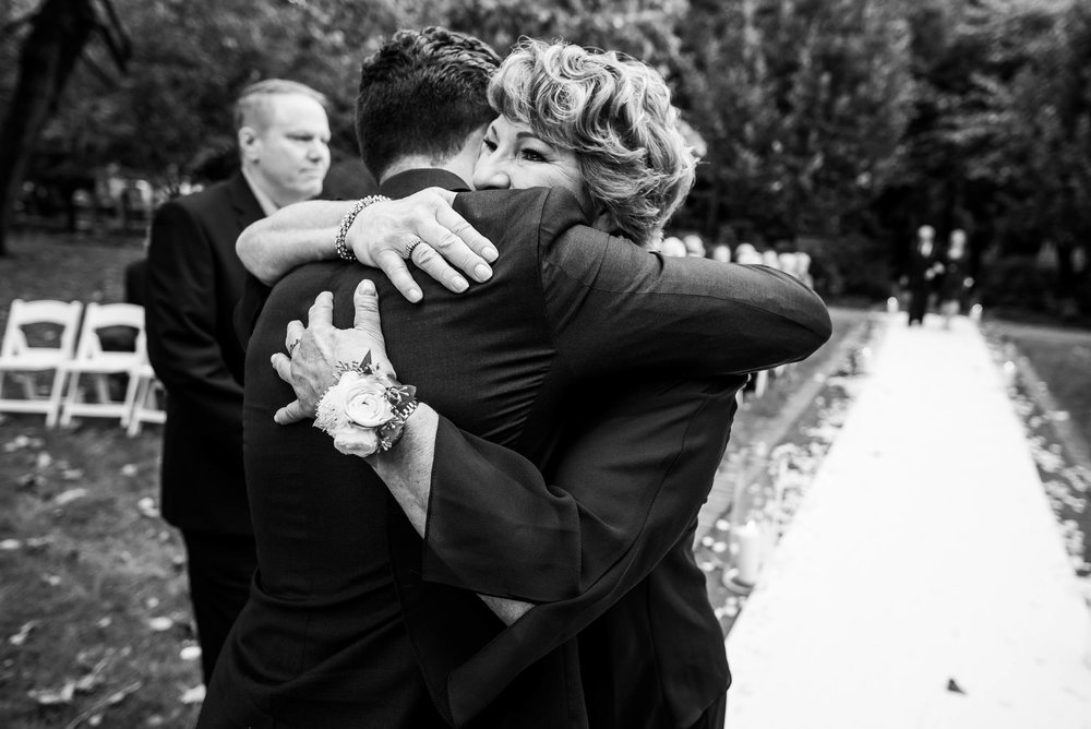 Groom and mom embrace during a Glessner House Chicago wedding.