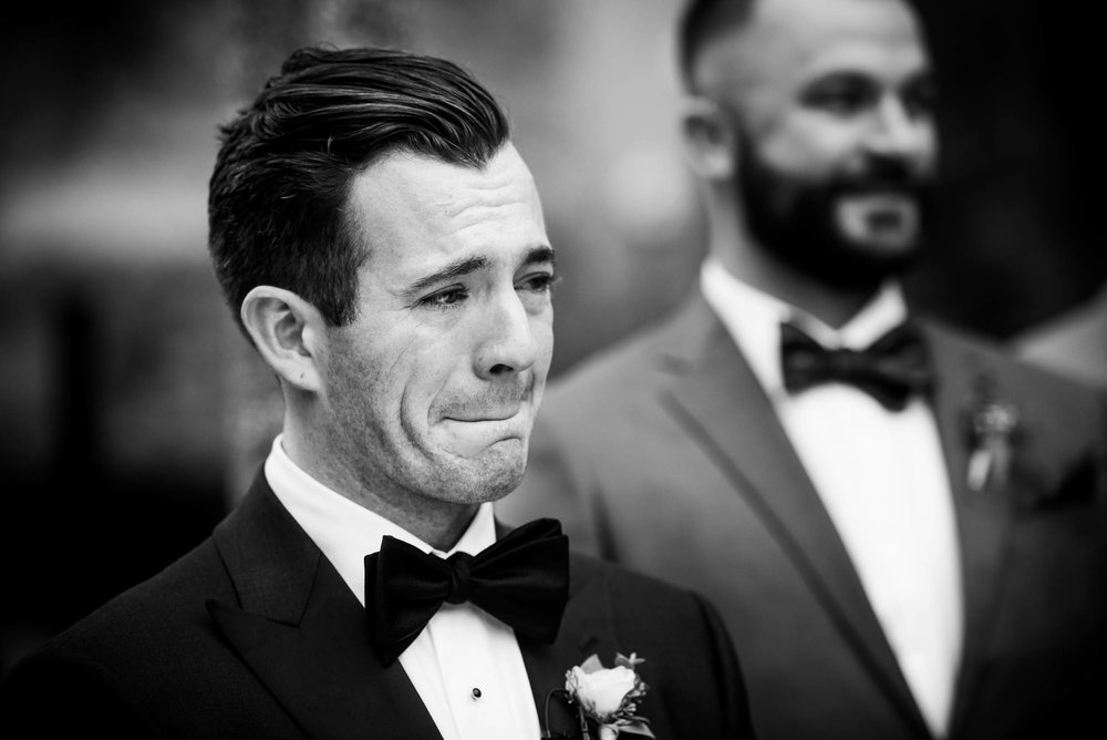 Groom reacts to his bride coming down the aisle during a Glessner House Chicago wedding.