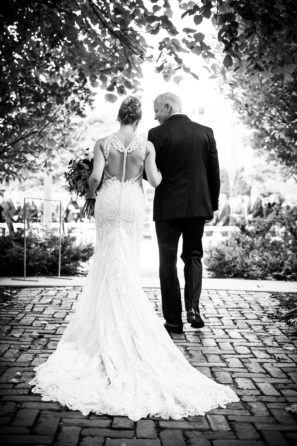 Bride and father walk down the aisle during a Glessner House Chicago wedding.