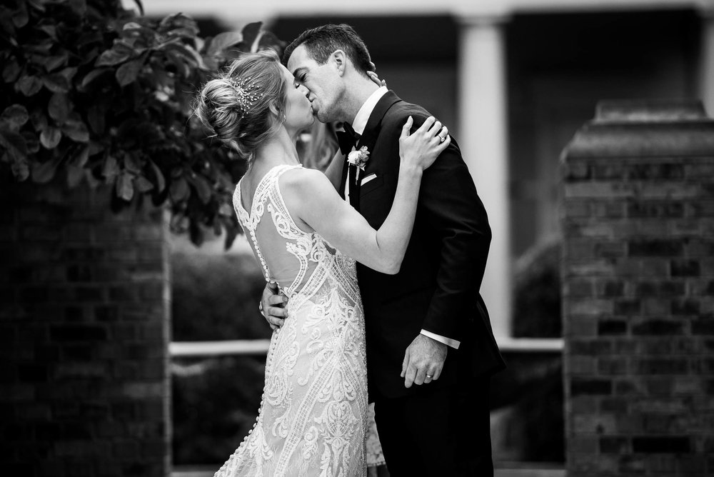 Bride and groom first kiss during a Glessner House Chicago wedding ceremony.